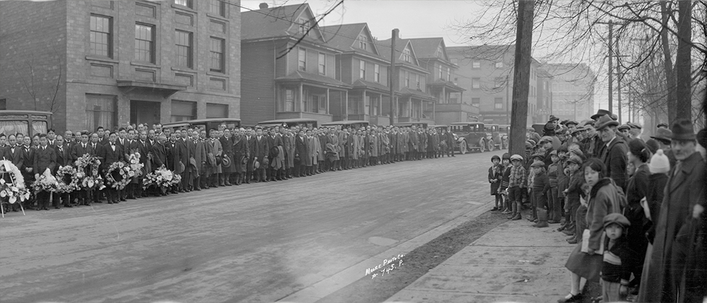 1929: The crowds here have gathered for the funeral procession of a prominent member of the Nikkei community. (Vancouver Archives)