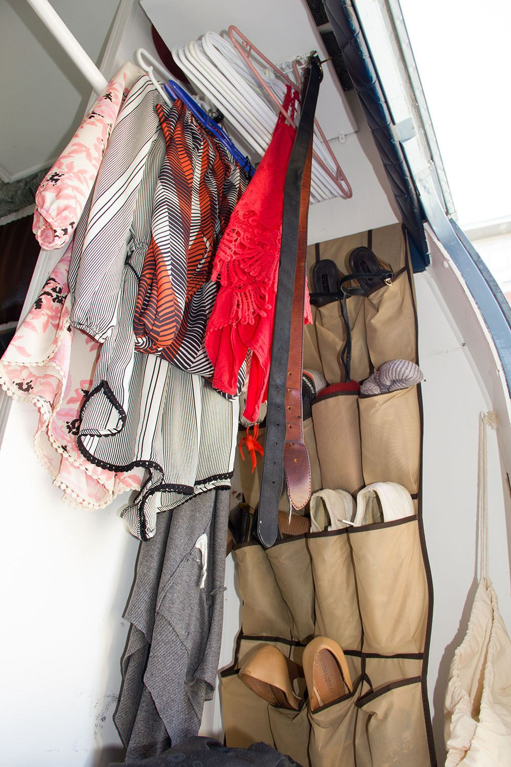 Emily Chambers has a small wardrobe and shoe rack in her van (Jenni Sheppard/Daily Hive)