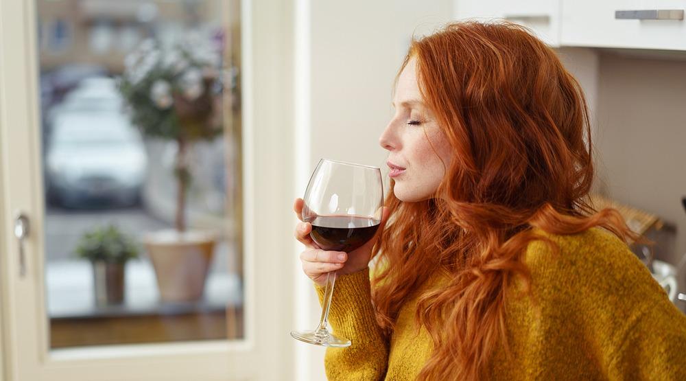 Woman drinking wine shutterstock