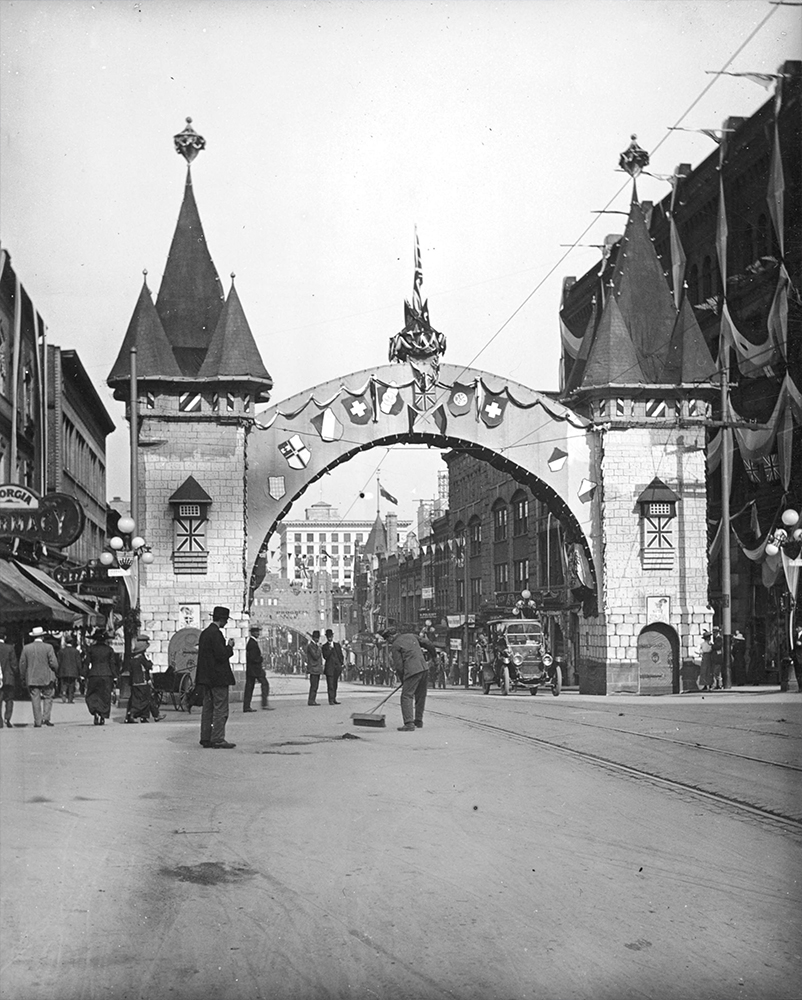 1912: A Model T can be seen if you zoom in on the right side of the arch erected by the German community to mark the visit of the Duke and Duchess of Connaught. (Vancouver Archives)