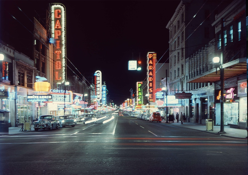 1959: A beautiful shot of 1950s Vancouver shows it exactly as one would imagine it today, with the bright colours, cool cars, and neon lights. (Vancouver Archives)