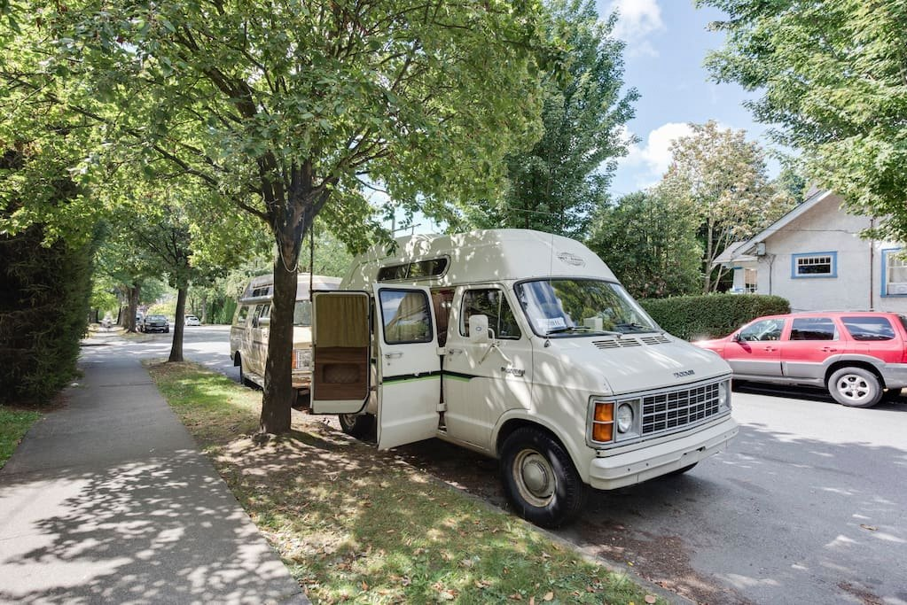 Moonbeam is parked on a leafy Kitsilano street (Luna/Airbnb)