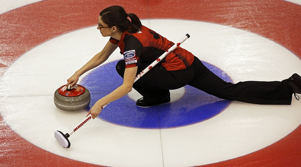 Canada's Lisa Weagle slides through the rings on a stone delivery at the Ford World Women's Curling Championship March 19, 2014 in Saint John, Canada (Jamie Roach/Shutterstock)