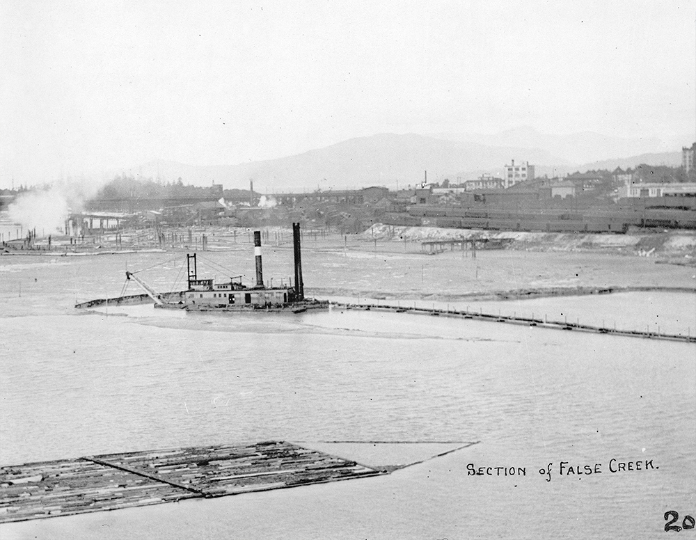 1910s: A rather bizarre-looking tug shuttles logging booms across False Creek. (Vancouver Archives)