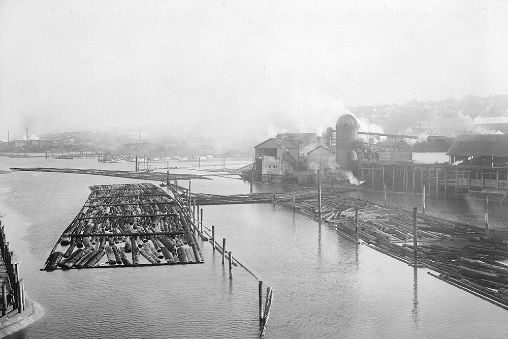 1916: Some of the land reclamation to create Granville Island has yet to occur and logging booms fill False Creek. (Vancouver Archives)