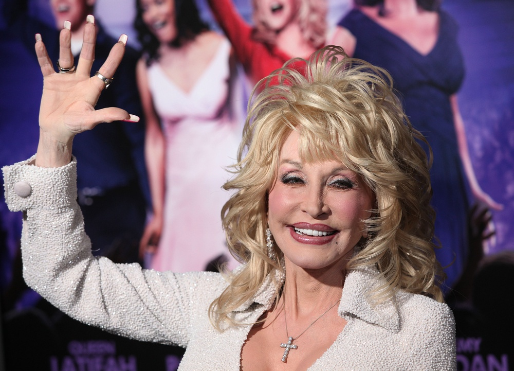 "Dolly Parton at the Los Angeles Premiere of ""Joyful Noise"" held at the Grauman's Chinese Theater in Los Angeles, California, United States on January 9, 2012 (DFree/Shutterstock)"