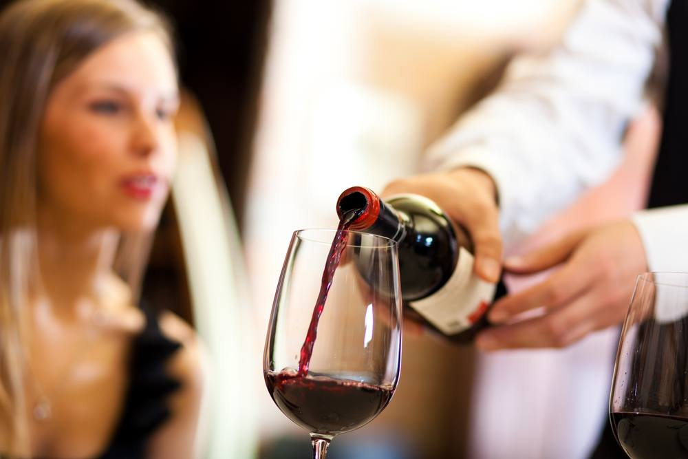 Red wine being poured minerva studioshutterstock
