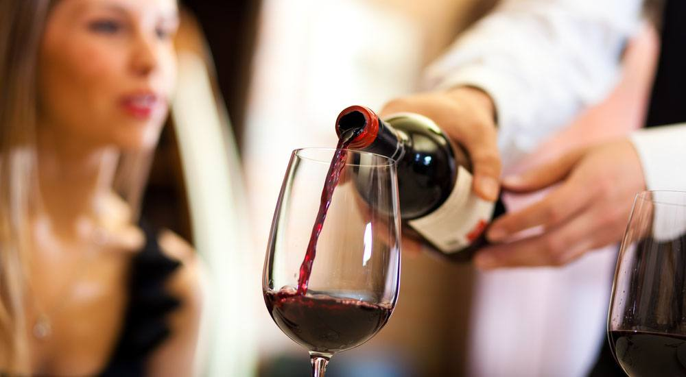 Red wine being poured minerva studioshutterstock1