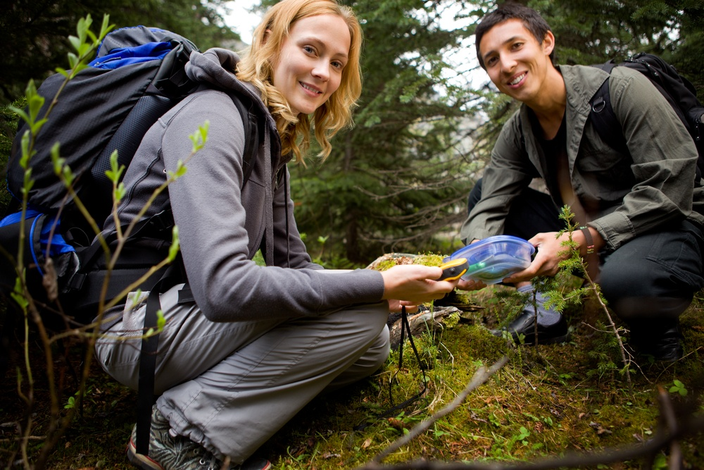 Woman and man geocaching (Tyler Olson/Shutterstock)