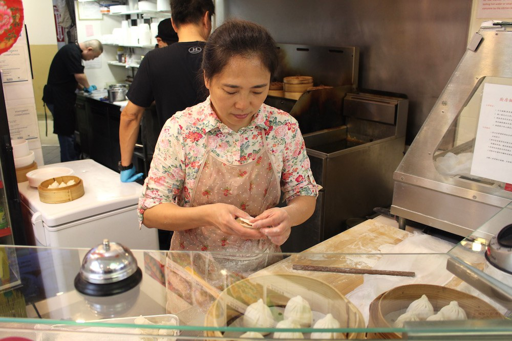 Filling and folding dumplings at R&H (Lindsay William-Ross/Daily Hive)