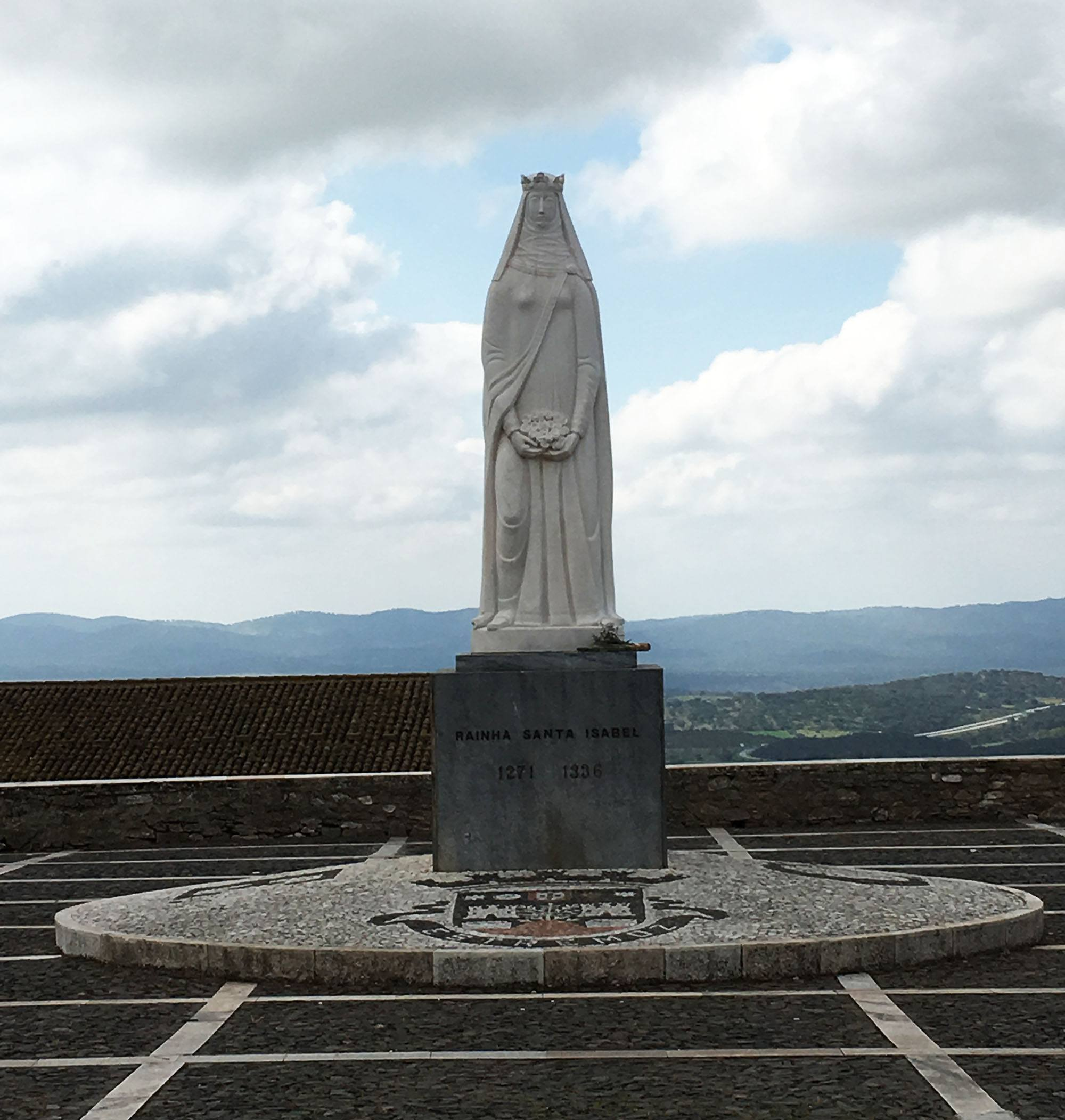 Outside of Estremoz Castle is a statue of Queen Isabel, for whom the castle was built. (Kevin Chong)