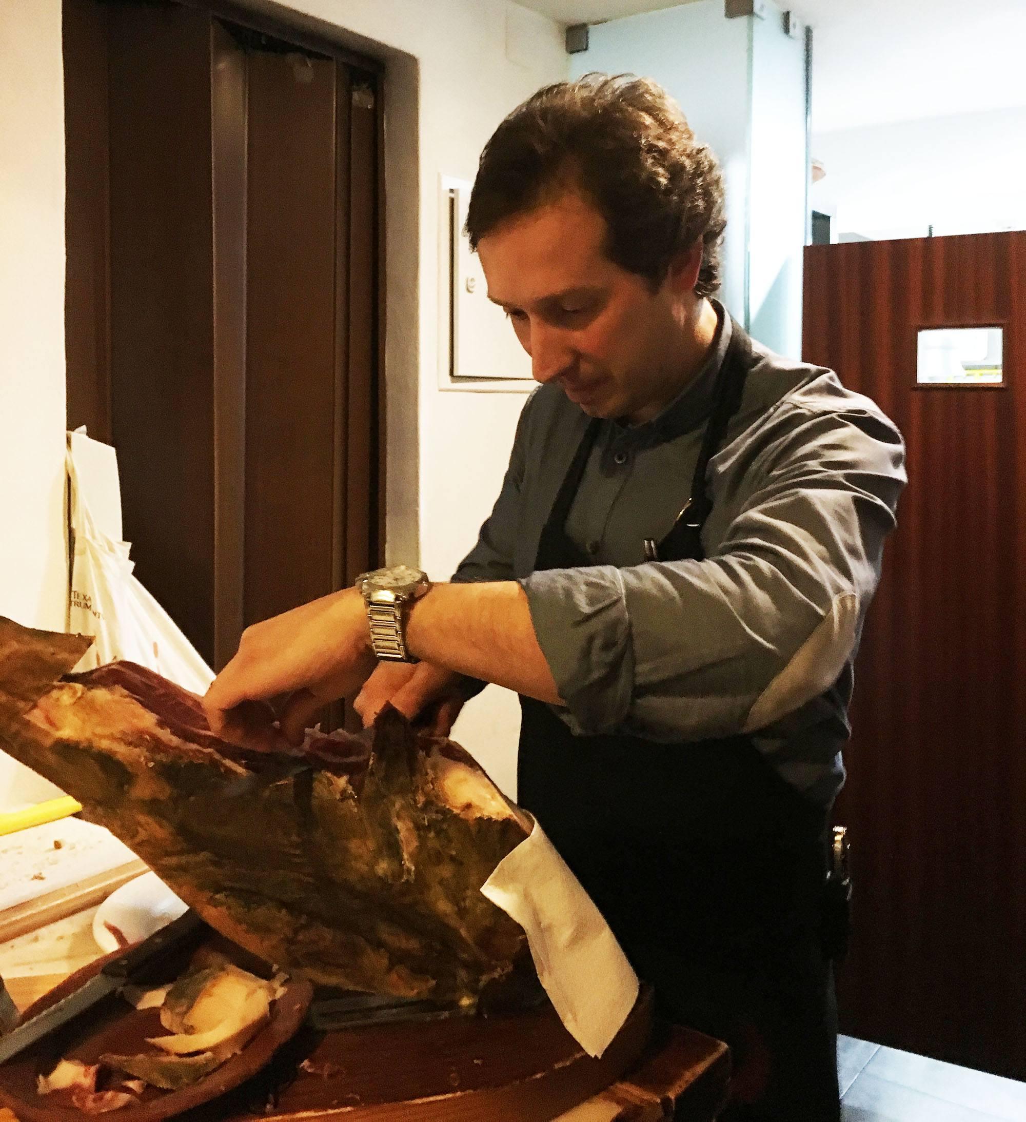 Delicious presunto (smoked ham) being sliced at Solar Do Forcado. (Kevin Chong)