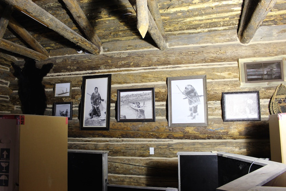 Vintage photos on display inside the checkout area, which is a trapper cabin--the lighting isn't ready yet. (Lindsay William-Ross/Daily Hive)