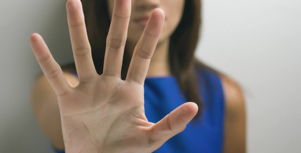 Woman denial hand