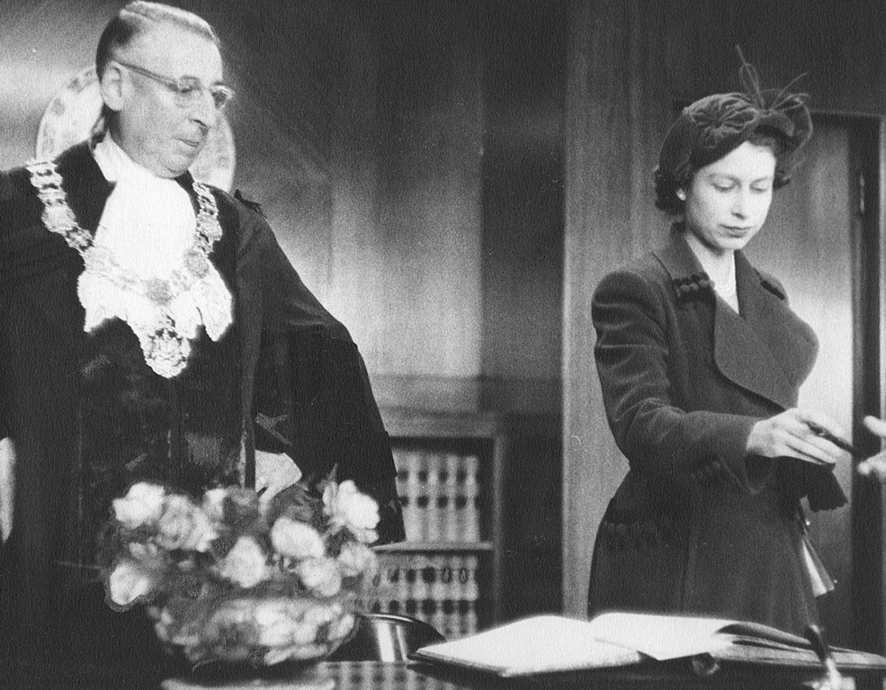 Princess elizabeth signs the visitors book in the mayors office 1951 city of vancouver