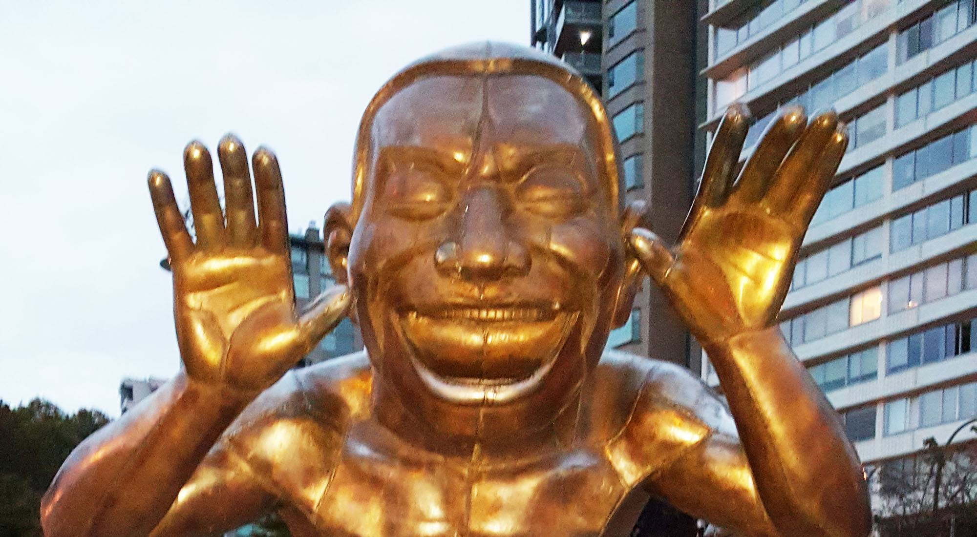 One of vancouvers laughing statues has been fitted with jeans mago 3d jeans feature