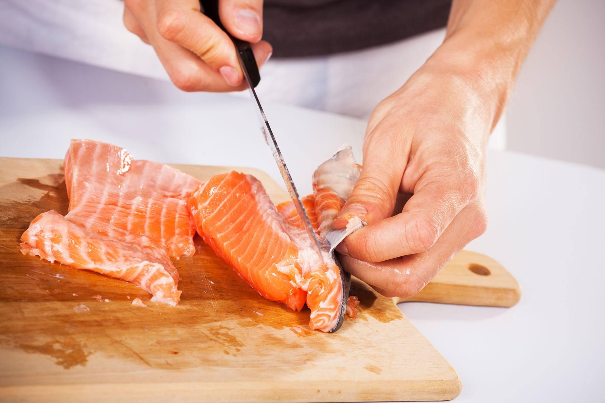 Filleting salmon (MilanMarkovic78/Shutterstock)