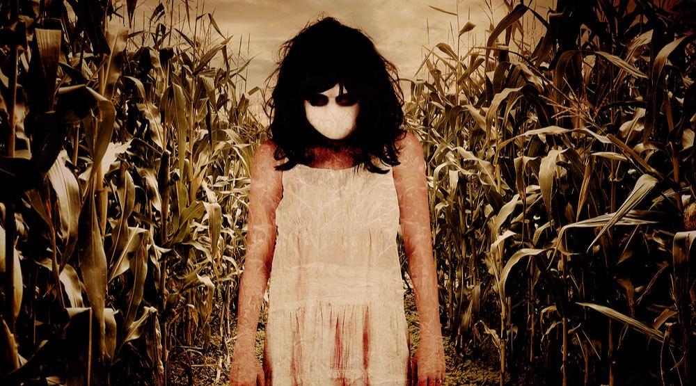 Zombie child in cornfield shutterstock