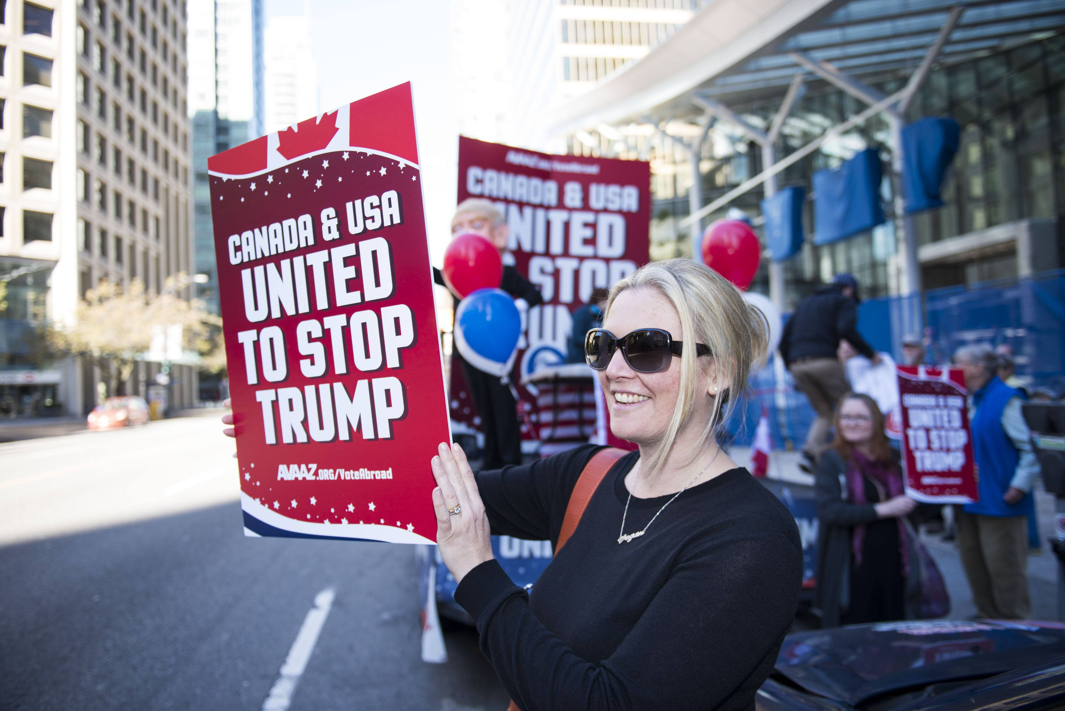 "A flat bed ""Stop Trump"" truck sits outside the new Trump Tower in downtown Vancouver organized by Avaaz to launch a major new campaign to mobilise American expats across Canada to register and vote, in Vancouver, B.C. on Wednesday, October 5, 2016. (THE CANADIAN PRESS IMAGES/Jimmy Jeong)"