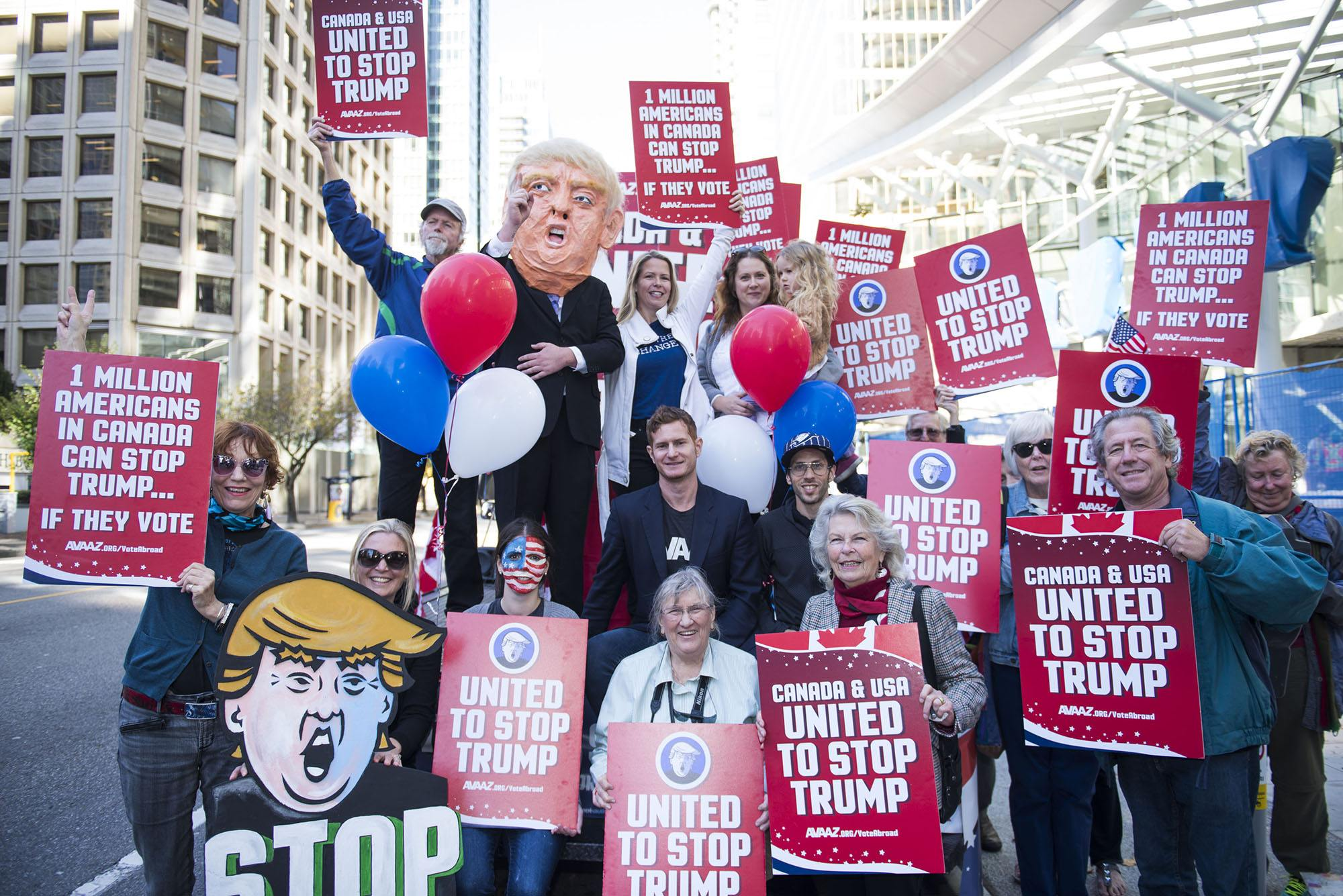 """A flat bed """"Stop Trump"""" truck sits outside the new Trump Tower in downtown Vancouver organized by Avaaz to launch a major new campaign to mobilise American expats across Canada to register and vote, in Vancouver, B.C. on Wednesday, October 5, 2016. (THE CANADIAN PRESS IMAGES/Jimmy Jeong)"""
