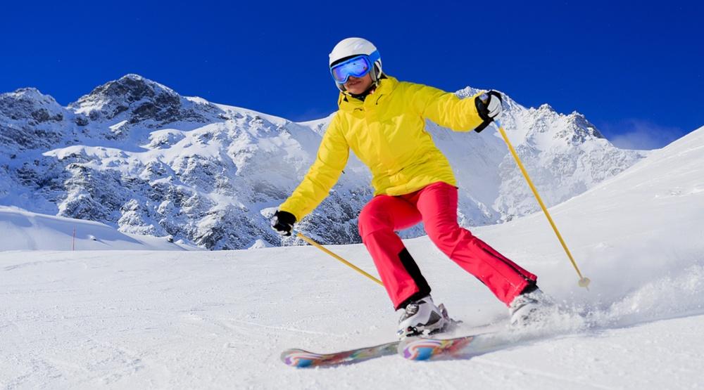 Skier skiing skis (gorillaimages/Shutterstock)