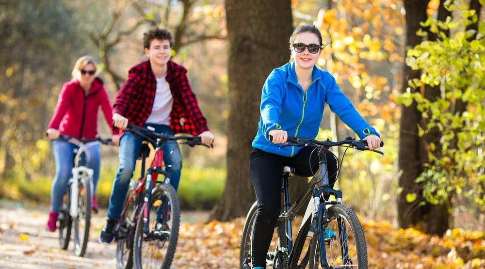 Women and men biking in fall (Jacek Chabraszewski/Shutterstock)