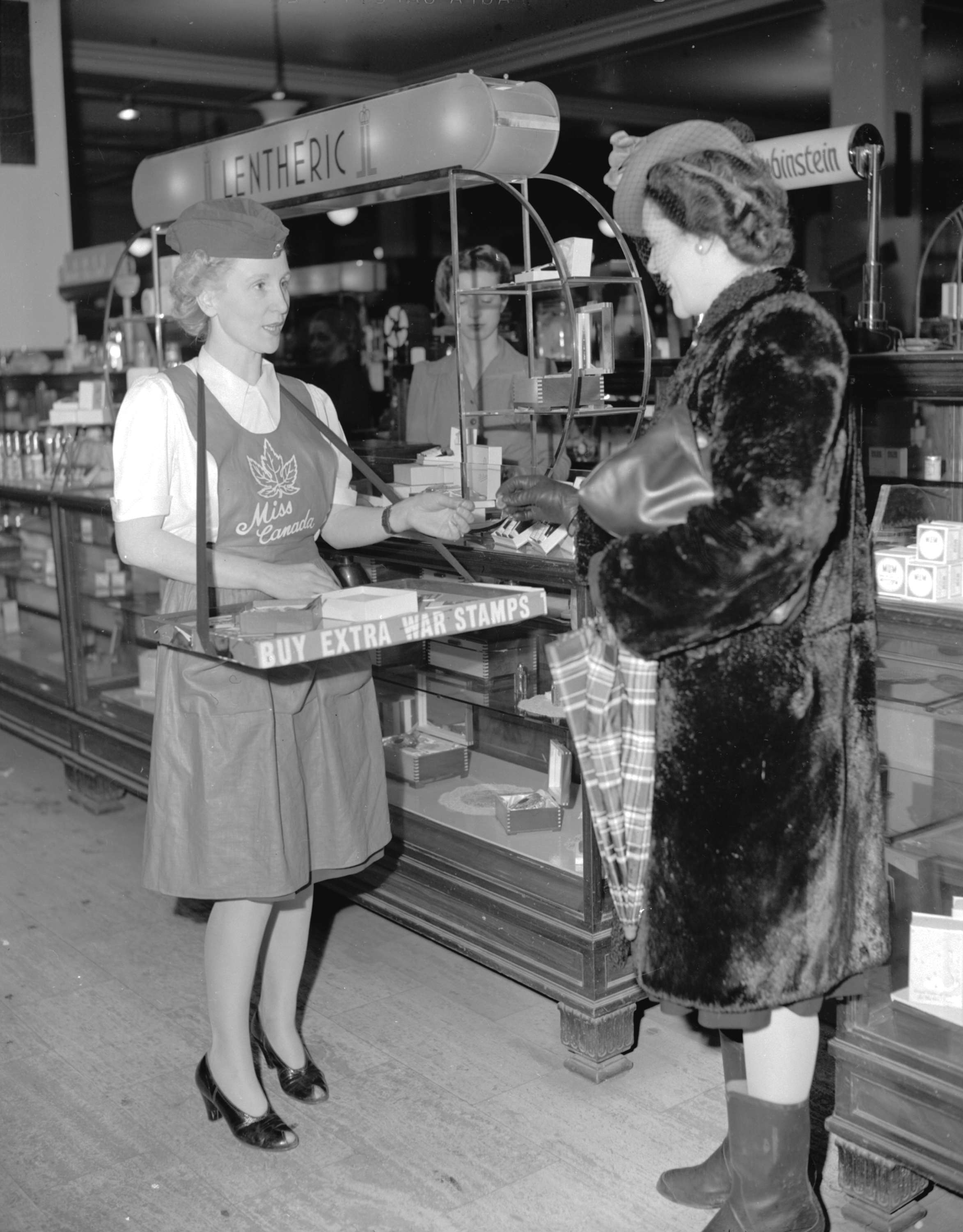 A saleswoman speaking to a customer at Spencer's Department Store in 1944 (Donn Williams)