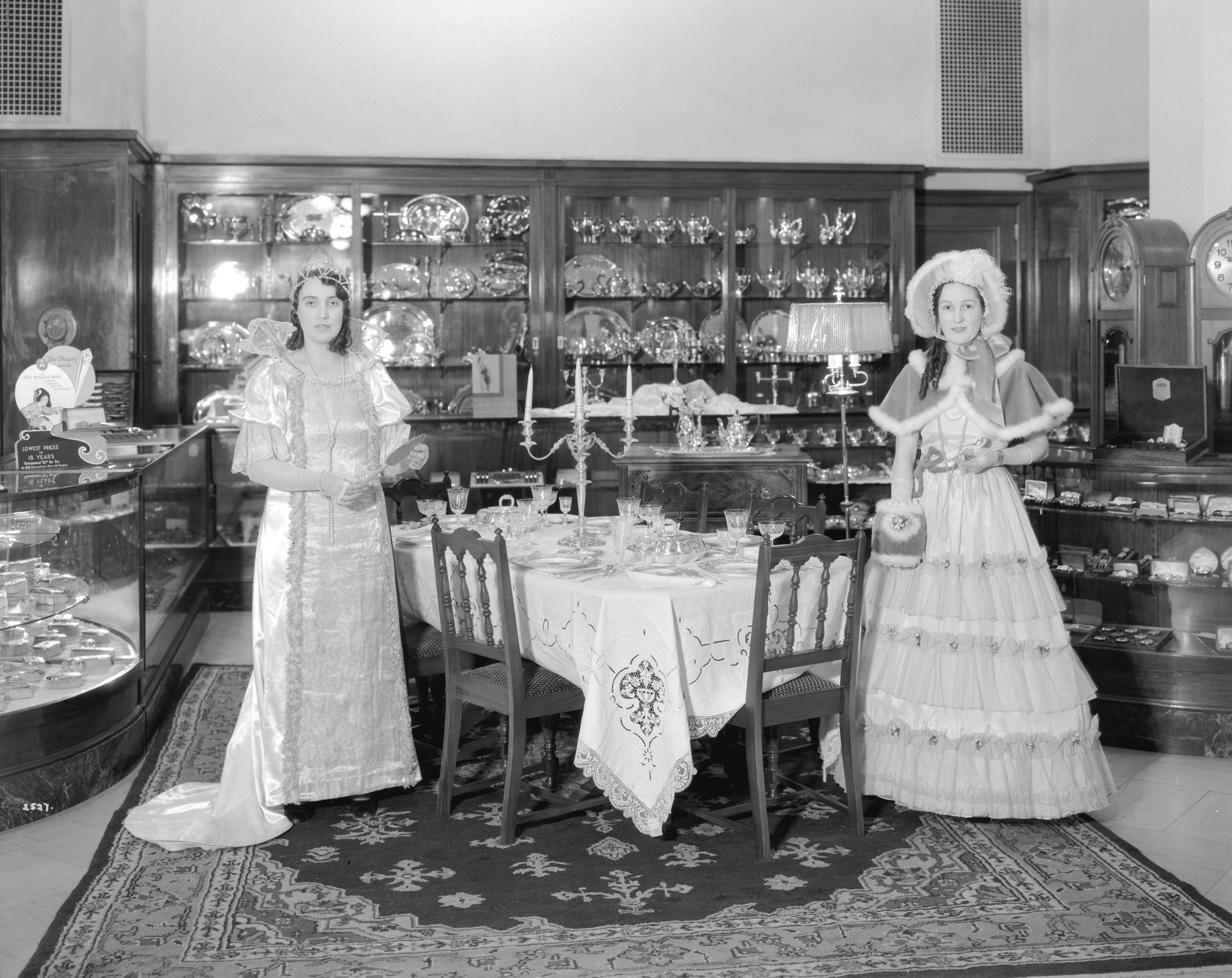 Models in period costumes display 'Community Plate' in the china and silverware department at Hudson's Bay in 1932 (Stuart Thomson/HBC)