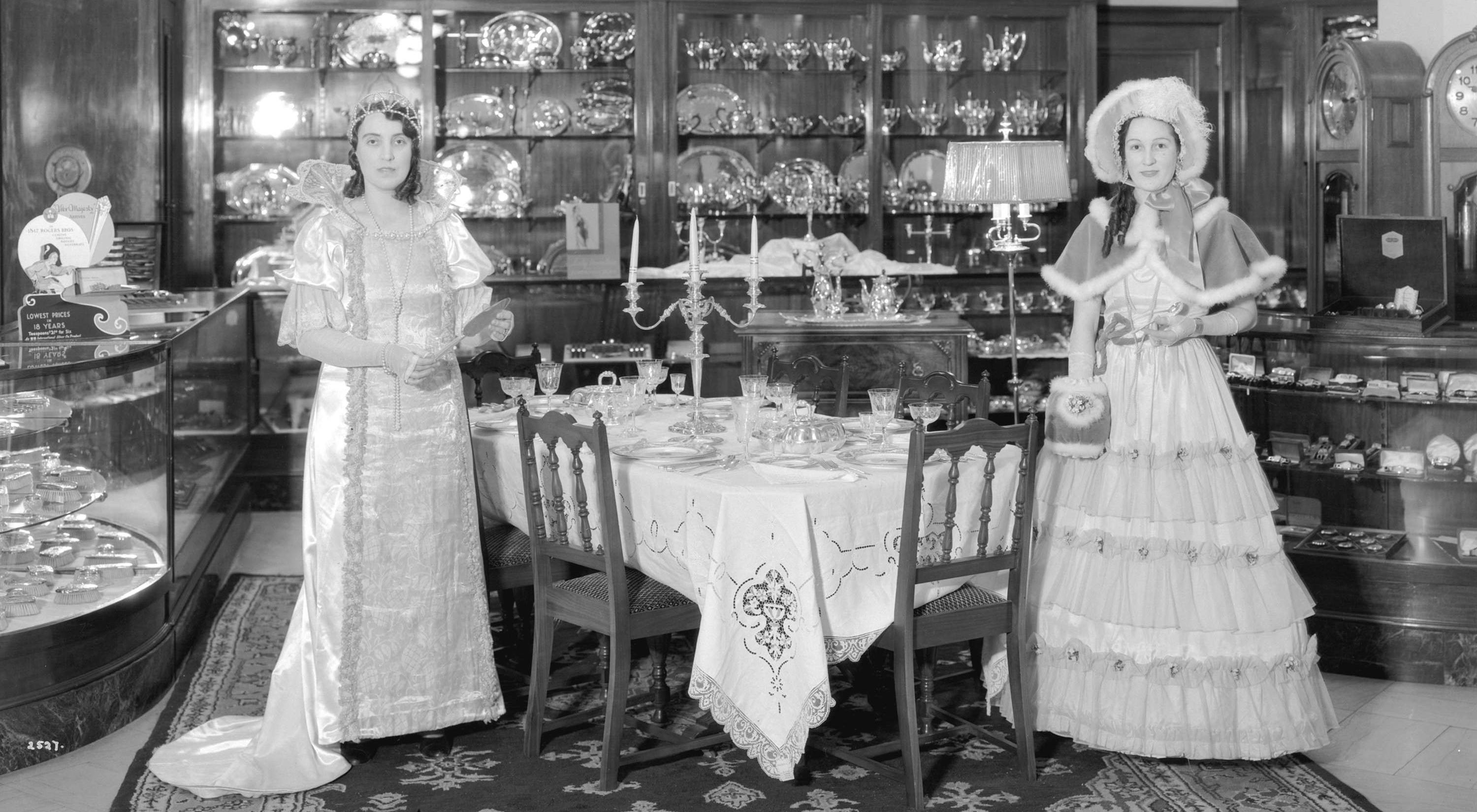 Models in period costumes display community plate in the china and silverware department at hudsons bay in 1932 stuart thomson hbc feature