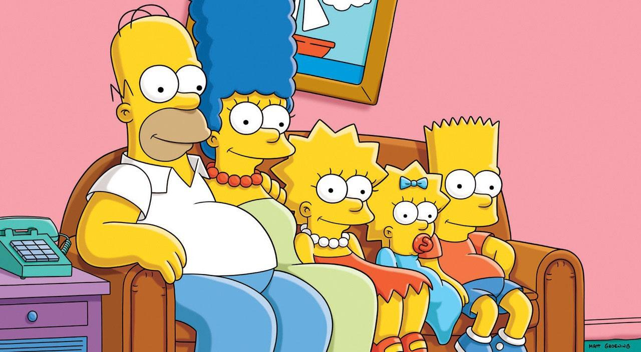 The simpsons sitting on the couch