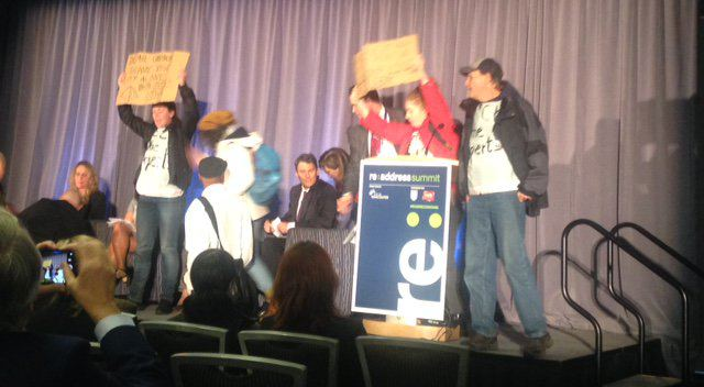Protesters storm stage of housing affordability summit in Vancouver (VIDEO)