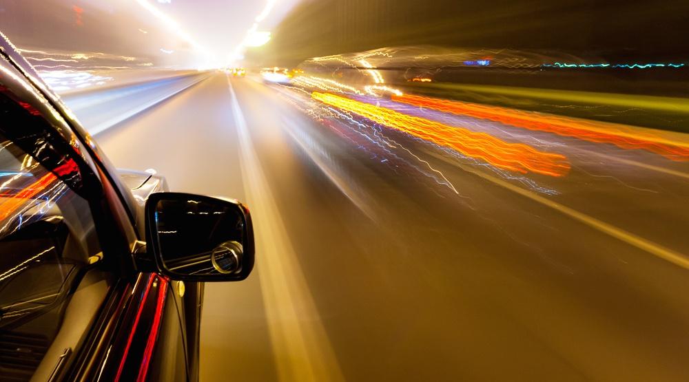 Car speeding traffic