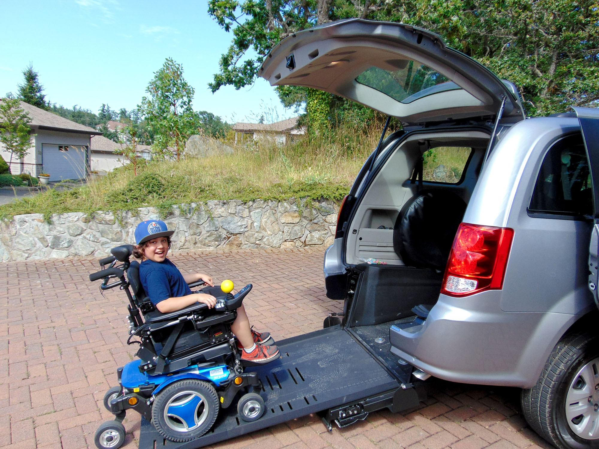 Dacian getting into his family's wheelchair-converted van (Variety)