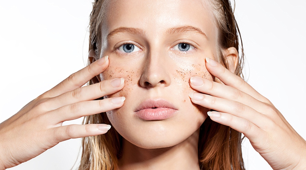 Woman using microbeads facial scrub to exfoliate her face beautystockphotoshutterstock
