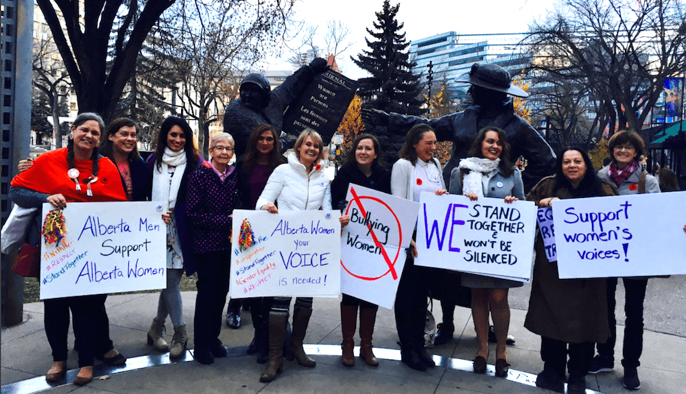 Rally to speak out against the bullying of women in politics takes over Olympic Plaza
