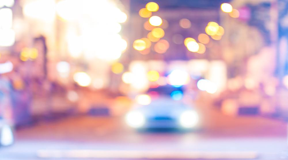 Blurred police car on the street at night shutterstock