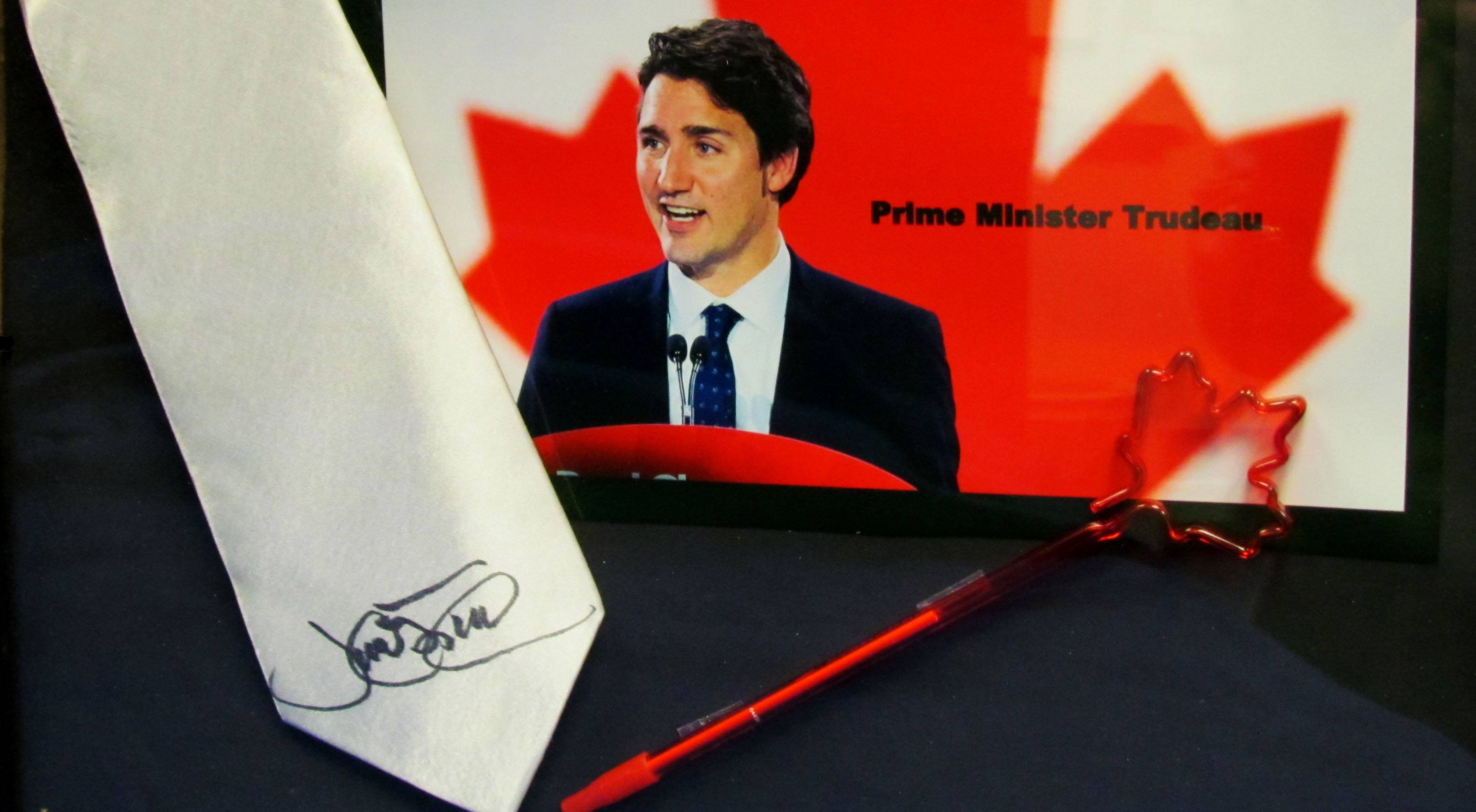 Justin trudeau has signed a tie for auctioning off on tie day royal city jewellers