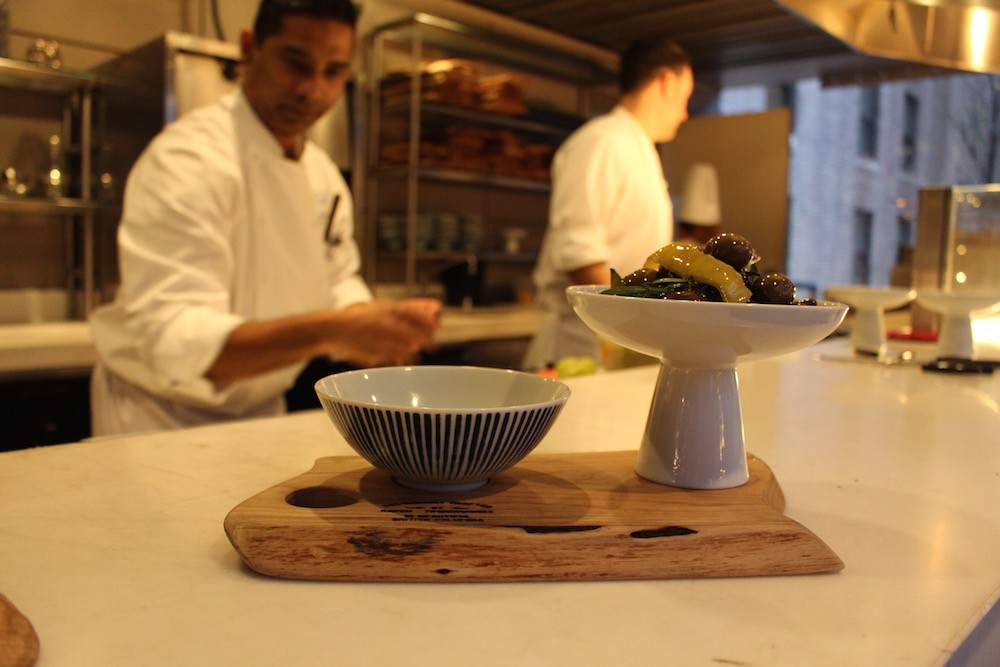 Prepping the winter menu in Reflections' open kitchen (Lindsay William-Ross/Daily Hive)