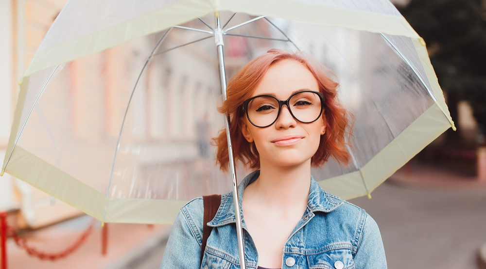 Woman in the rain with an umbrella sergey causeloveshutterstock