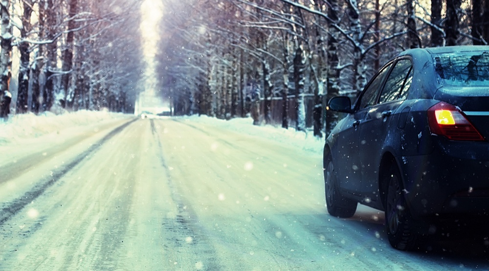 Car driving in the snow shutterstock