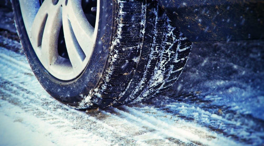 Tire of car driving in snow and ice (Juergen Faelchle/Shutterstock)