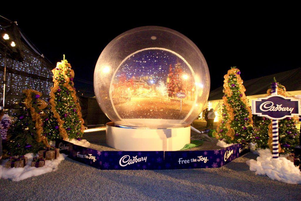 life size snow globe hits enchant christmas light maze photos