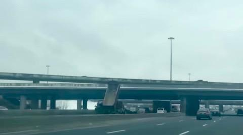 Transport truck smashes into highway 401 overpass (VIDEO)
