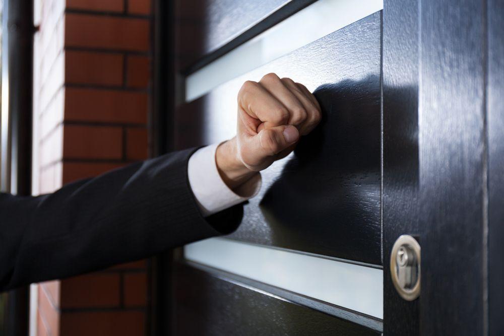 Door to door salesman shutterstock