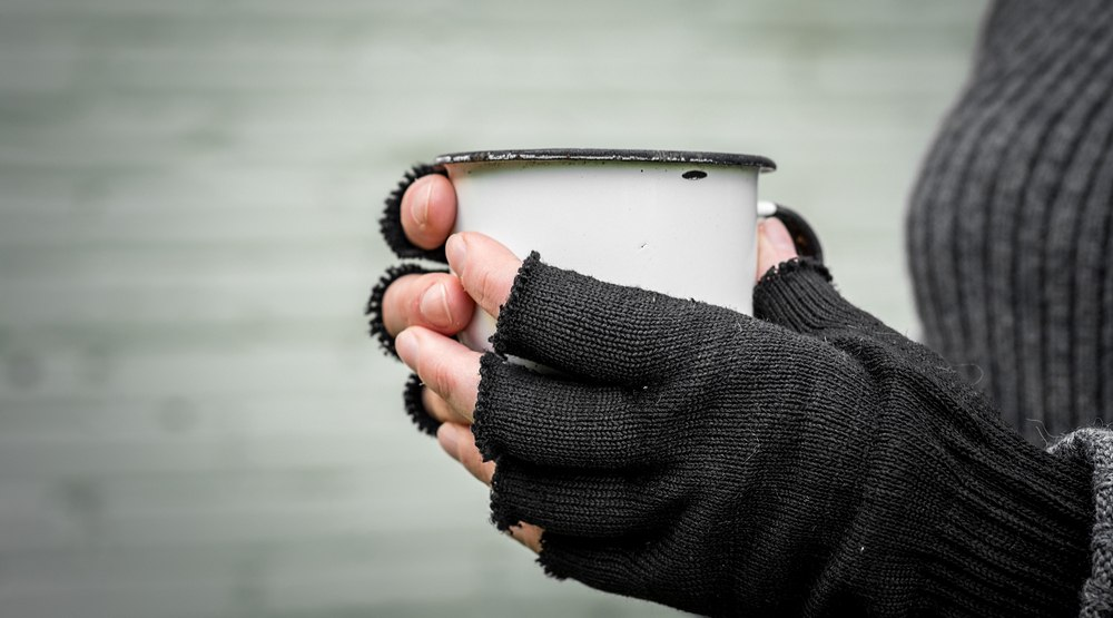 Cold hands, warm drink - homelessness (Discha-AS/Shutterstock)