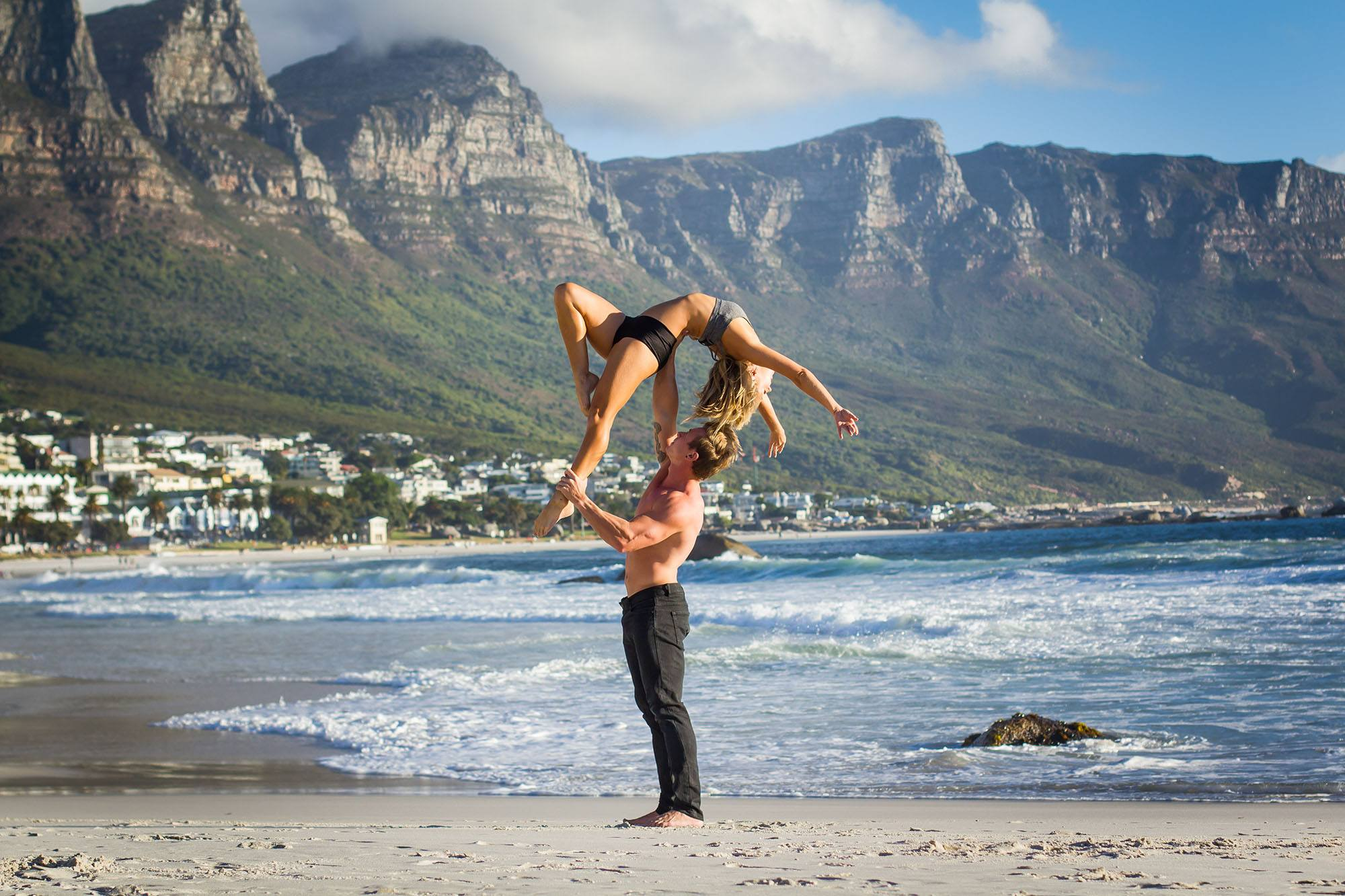 Nicole and James soaring on Glen beach, Cape Town (Amanda Webb)