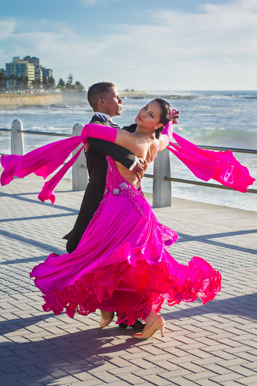Dedicated elegance. Percephone and Angelo ballroom dance along the promenade in Cape Town. (Amanda Webb)