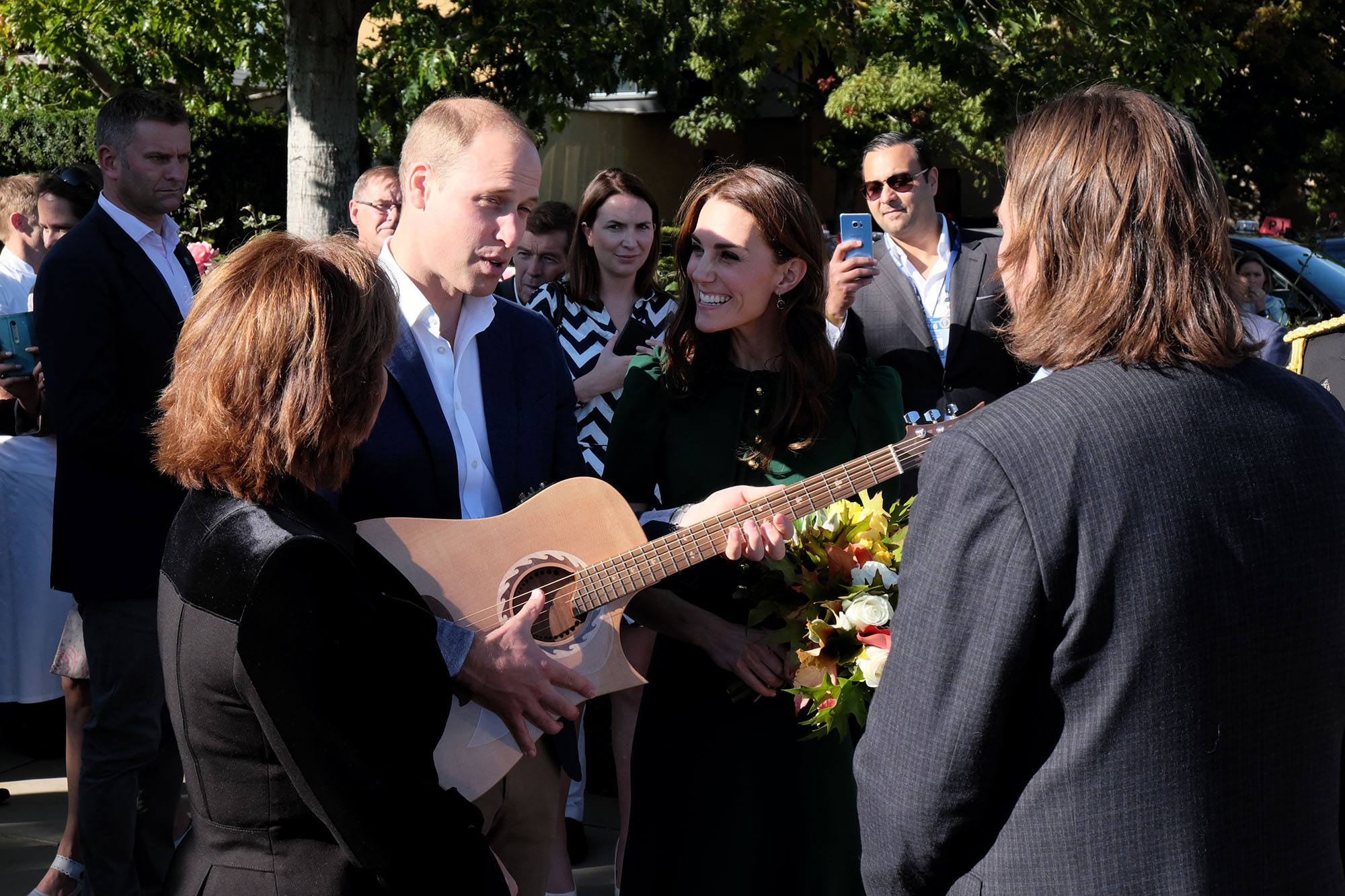 Prince William receives a guitar from Riversong Guitars in Kamloops during the royal tour of BC in 2016 (Province of BC)