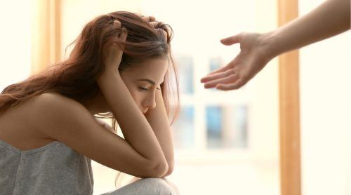 Woman feeling depressed or suicidal getting support and help (Africa Studio/Shutterstock)