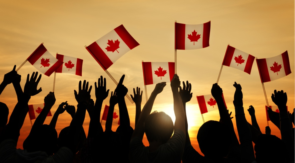People waving canadian flags rawpixel.comshutterstock